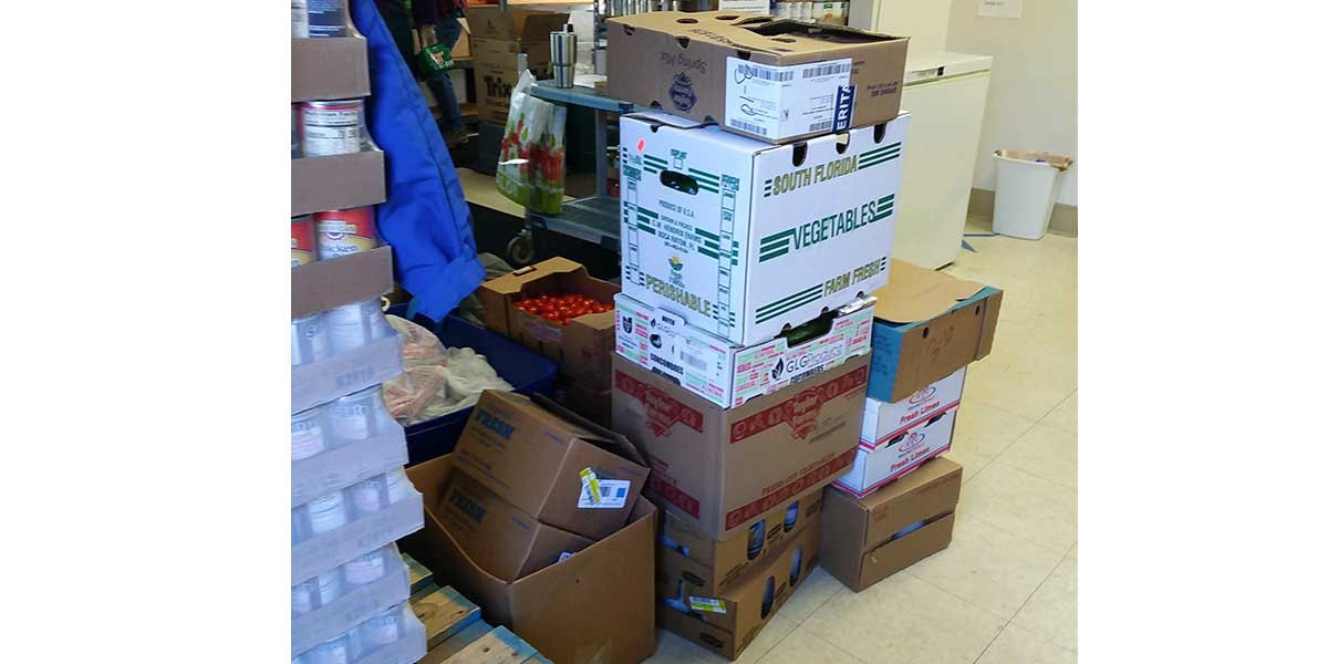 Hundreds of pounds of food packed up by Finger Lakes team members